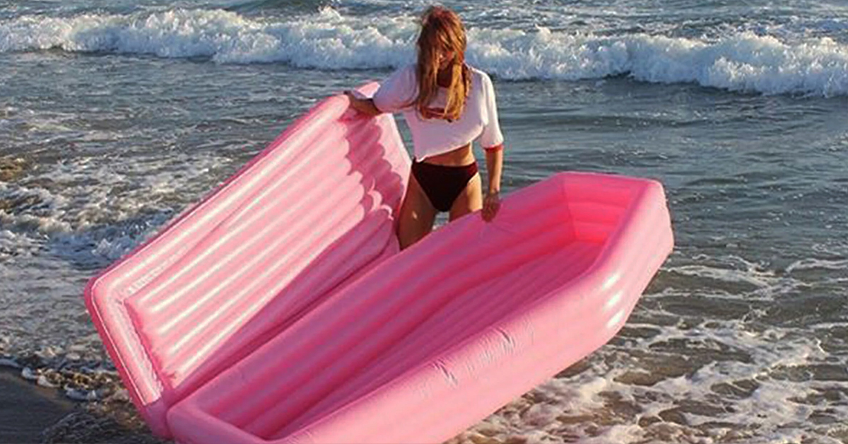 This Pink Coffin Pool Float Is The Biggest Summer Mood