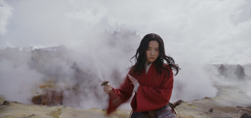 Asian woman standing on a foggy batthfiled, holding a sword.